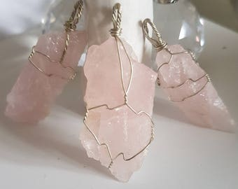 Rose quartz silver wire wrapped pendant including adjustable thong..each piece is completely unique