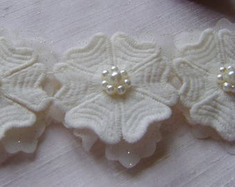 An Ivory 3D Floral Trim with Pearl Centre