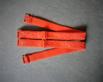 2 removable red elastic straps with adjustment system