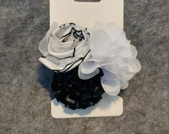 Black and white flower hair bow.