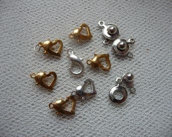 Set of 10 small gold and silver metal clasps