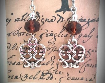 Warm amber brown crystal earrings with silver filigree charm