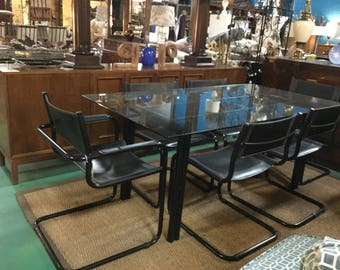 italian marcel breuer style black powder coated base dining set with six leather chairs 2 arms