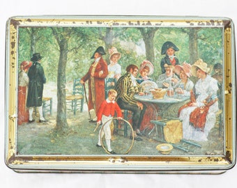 "Belgian storage-tin made by ""Demaret Confiserie Brussels"" in goldcolor, depicting ""Sous les Tuilleus""  by L. Dansaert."