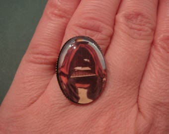 ring with oval glass cabochon, Magritte painting