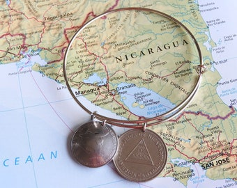 Nigaragua coin bangle bracelet - 2 different designs - made of original hand curved coins - white dove - map - triangle