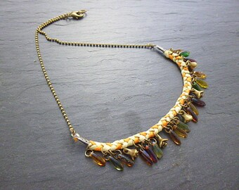 Necklace Pearl daggers and braided silk orange/yellow/green