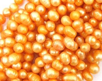 "8mm orange freshwater pearl potato beads 15.5"" strand 16159"