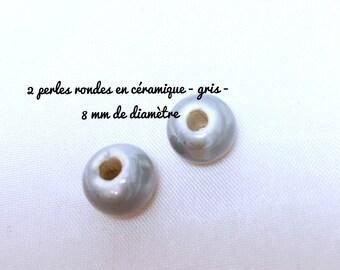 2 round ceramic beads - grey - 8 mm in diameter approx