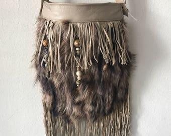 Beige fur hand made shoulder bag .