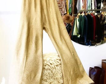 Sold in store. Do not buy. Vintage Seventies 1970s Gold Lame' High Waist Wide Leg Pants. Disco. Bowie. Size Medium.