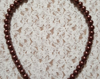 Brown beaded necklace with brown pendant