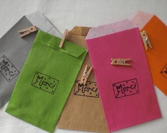 "Five bags ""merci"" with small wooden clips"
