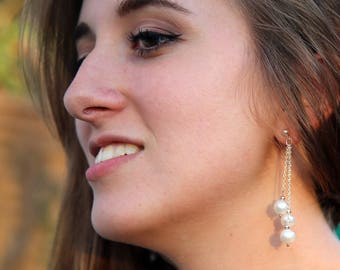Beautiful earrings made with high quality white cultured pearls and Sterling Silver, handmade