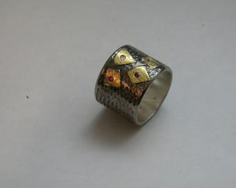 handcrafted contemporary silver gold K18 ring with rubies and brilliants