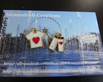2 enamel charms representing a tshirt and his white pants and red heart pattern