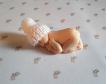 Miniature white baby bonnet in handmade fimo knit tassel