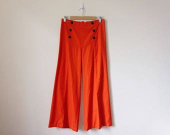 Handmade 70s high waisted red wide leg flares with black buttons