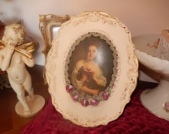 Romantic paintings with worked oval frame portrait of woman surrounded by Pink fabric