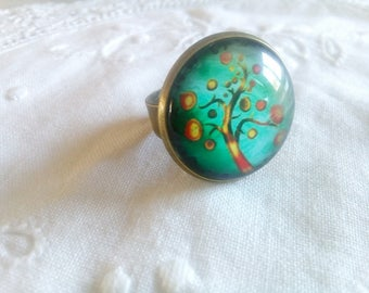 Ring cabochon tree of life on green background