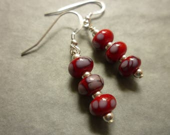 Lampwork glass bead earrings in red and pale grey with silver beads and sterling silver earwires