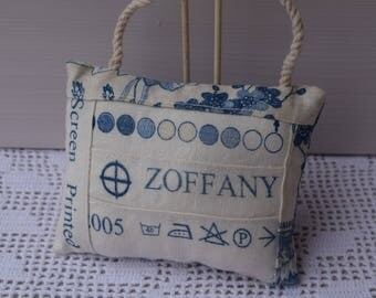 Decorative door - stitched fabric needle - pad cushion bands recovery on upholstery fabric - pin cushion.