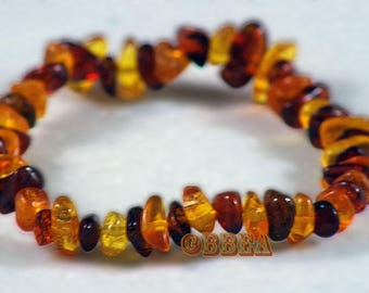 Amber chips strung on elastic cord 5 mm baby bracelet