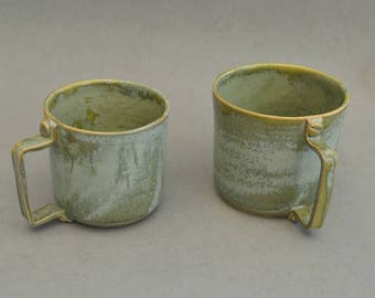 Coppery green mugs with screwed-on handle