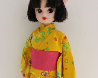 Kimono Licca doll with tilted head.