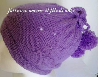 Baby hat with pom pom and hearts