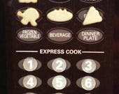 Tactile Icon Stickers and Keypad Stickers for a Microwave Oven