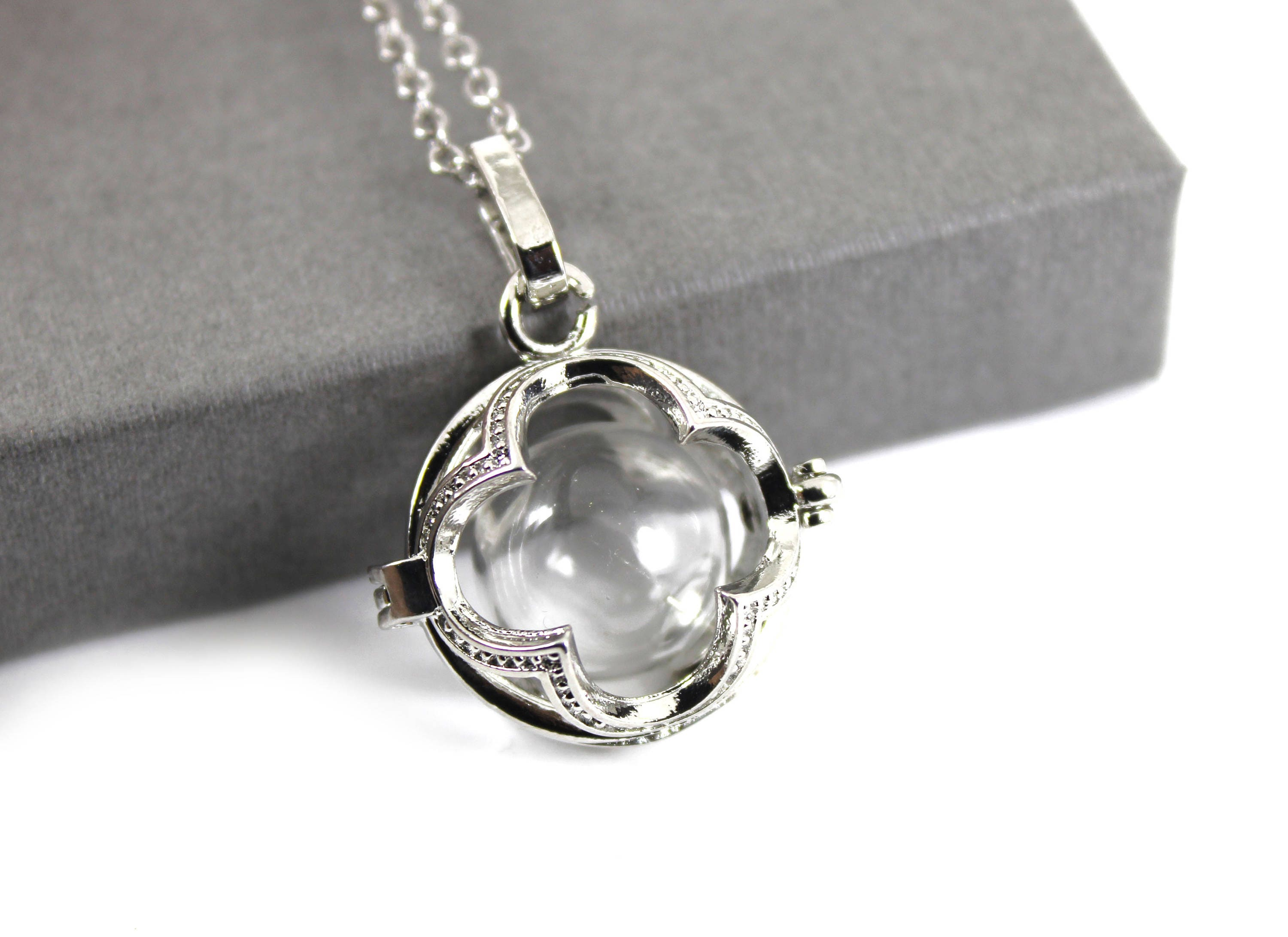 openwork flower locket with fillable glass orb memorial