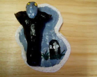 Vampire with black cape, polymer clay.