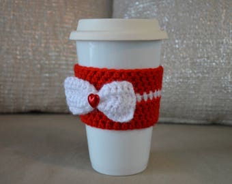 Red crochet cup cozy with a white bow for Valentine's Day!