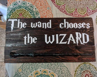 HP the wand chooses the wizard sign