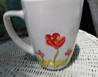 Mug with red flowers and a coordinating spoon. Hand painted