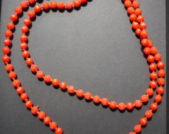 Long single strand red plastic pop poppit beads with rose design