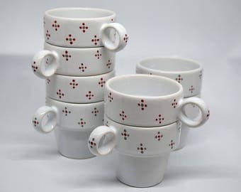 4 hand painted porcelain coffee cups.