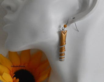 Spiral earrings gold with Nespresso capsules