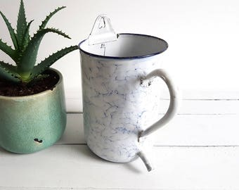 Vintage clouded enamel planter with integrated water spout