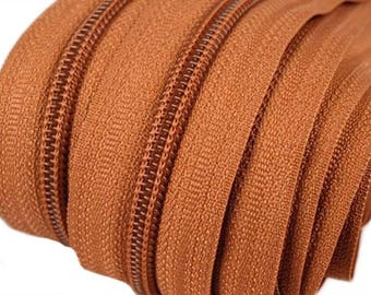 6m of endless zipper 5mm with 15 zippers and tails 280 ochre
