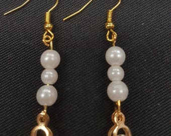 Gold plated diamante and white beaded earrings