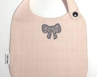 Blush cotton bib with pink snap