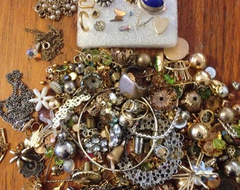 Lot of miscellaneous jewelry pieces. 6.1 oz of beads, chains, earrings. Sold as is.