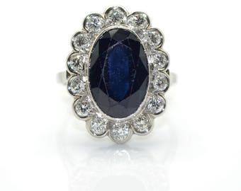 Surrounding Sapphire and diamond ring