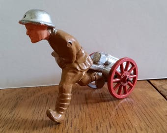 World War #1 Manoil lead soldier running with cannon, 99% mint and original, dimestore soldiers, lead soldiers, lead figures, military toys