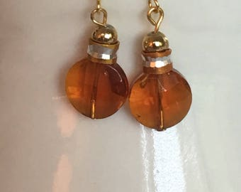 Copper earrings. Brown earrings. Topper dangle earrings. Brown dangle earrings. Cop or drop earrings. Gold and copper trim