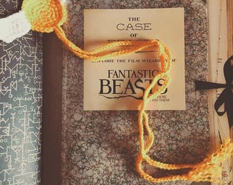 Harry Potter handcrafted crochet Golden Snitch bookmark.
