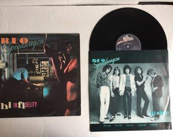 Vintage Vinyl Record - REO Speedwagon hi indefinitelyEPC84700 Epic Records Made In Holland (Netherlands) 1980