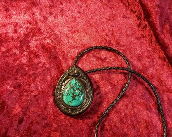 Black leather with a Turquoise necklace